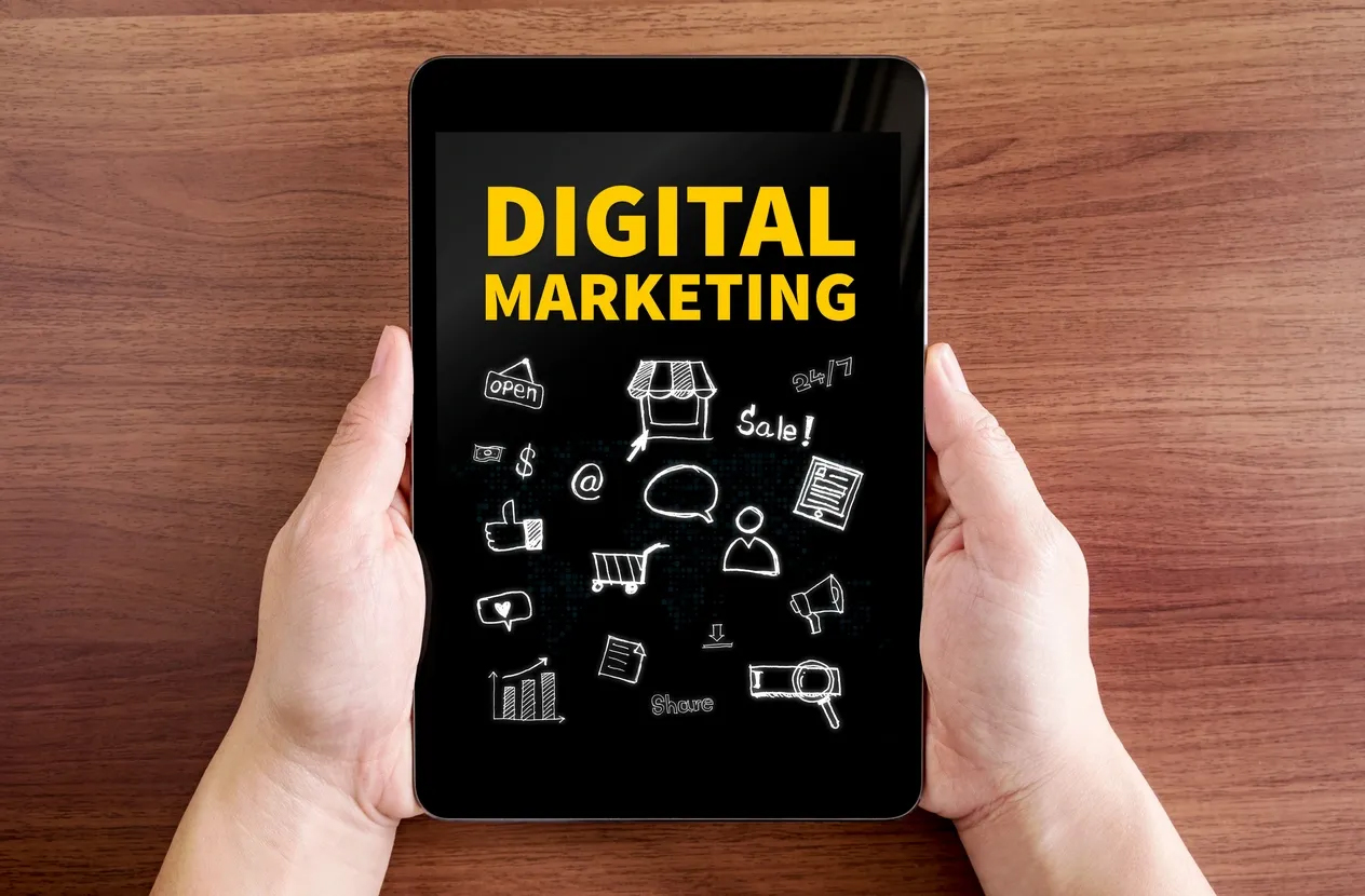 """Tablet displaying the phrase """"digital marketing"""" and associated icons"""